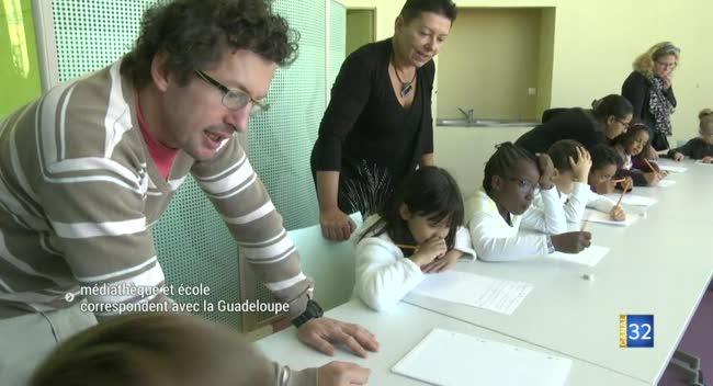 Canal 32 - Troyes : Médiathèque et école correspondent avec la Guadeloupe